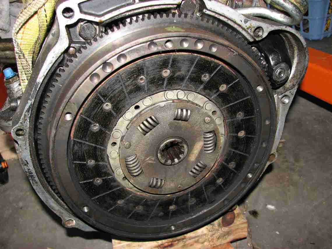 Engine Clutch Plate : Flywheel clutch and mounting engine stand